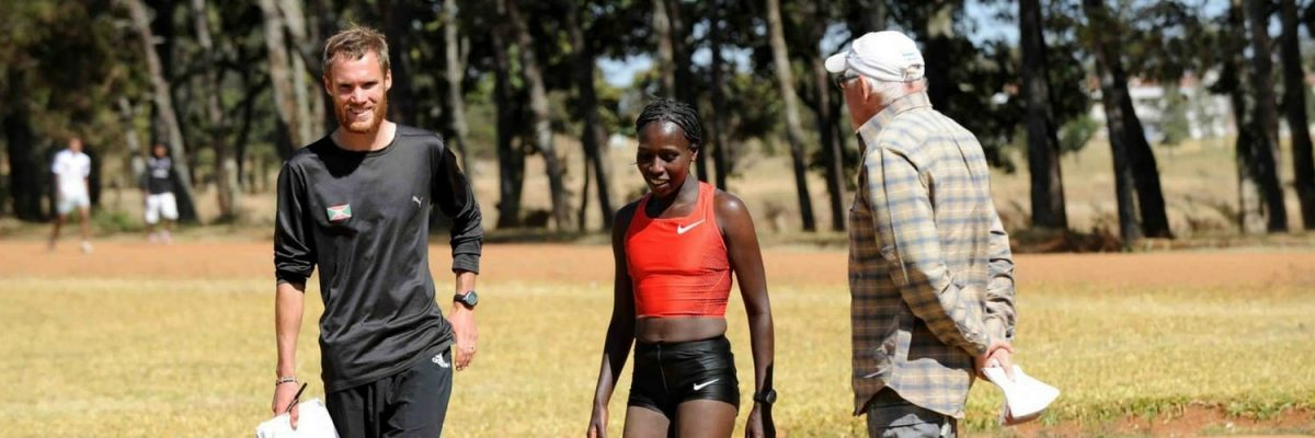 Gavin Smith (KE founder) with coach Renato Canova and athlete Florence Kiplagat